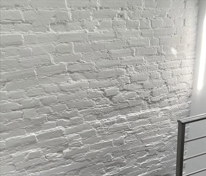A clean white brick wall.