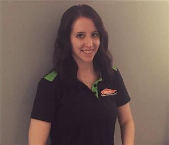 Female Servpro employee smiling