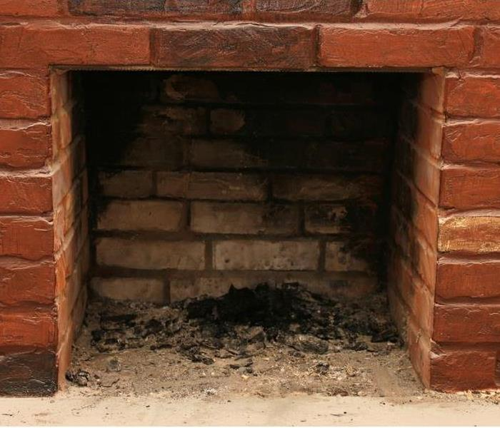 A fireplace that has old soot and ash
