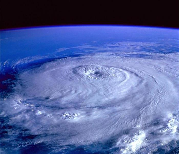 A spiraling hurricane seen from space.
