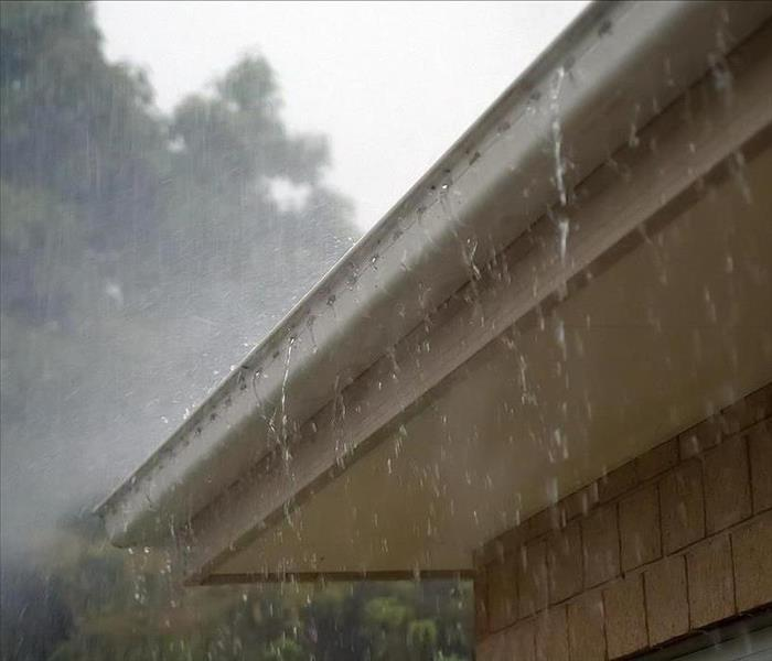 Heavy rainfall hitting a home